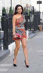 Kelly Brook leaves her home wearing a very short off the shoulder black and red dress, with black peep toe heels and a clutch bag.  With her long legs on display Kelly arrived at the Sanctum Hotel in central London. UK. 26/06/2013<br />BYLINE MUST READ : GOTCHAIMAGES.COM<br /><br />Copyright by © Gotcha Images Ltd. All rights reserved.<br />Usage of this image is conditional upon the acceptance <br />of Gotcha Images Ltd, terms and conditions available at<br />www.gotchaimages.com