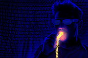 Man with dark glasses blows a whistle in front of a curtain of binary code.Black light