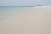 Sea waves coming to white sand beach. Pacheca Islands, Las Perlas Archipelago, Panama, Central America.