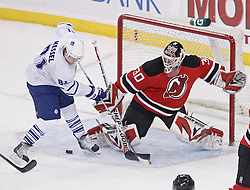 Jan 29, 2010; Newark, NJ, USA; New Jersey Devils goalie Martin Brodeur (30) makes a save on Toronto Maple Leafs right wing Phil Kessel (81) during the third period at the Prudential Center. The Devils won 5-4 in overtime.