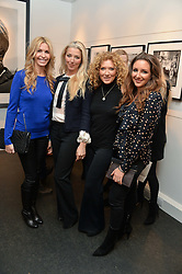 Left to right, MELISSA ODABASH, TAMARA BECKWITH, KELLY HOPPEN and NATASHA CORRETT at a private view of photographs 'Terry O'Neill-The Best Of' held at The Little Black Gallery, 13A Park Walk, London on 16th January 2014.