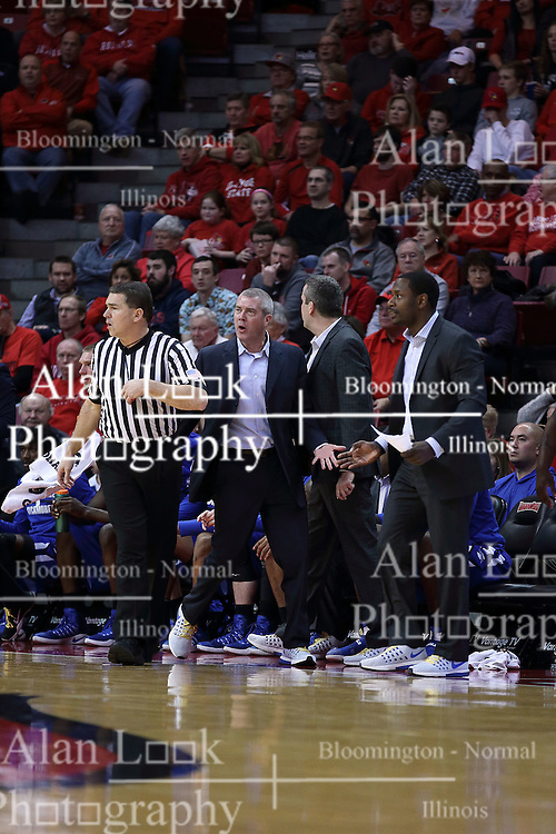 20 January 2017:  Greg Lansing screams towards the floor as Paul Janssen walks away during an NCAA Missouri Valley Conference mens basketball game Where the Purple Aces of Evansville lost to the Illinois State Redbirds 75-73 in Redbird Arena, Normal IL