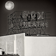 Full moon sets behind the Fox Fullerton Marquee in the early morning hours.