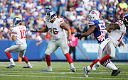 New York Giants offensive tackle Ereck Flowers (76) pass blocks during the 2015 NFL week 4 regular season football game against the Buffalo Bills on Sunday, Oct. 4, 2015 in Orchard Park, N.Y. The Giants won the game 24-10. (©Paul Anthony Spinelli)