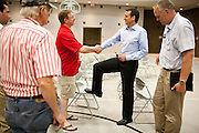 Former Minnesota Gov. Tim Pawlenty greets Iowans while campaigning for the GOP presidential nomination during a town hall event at the Iowa Farm Bureau in Des Moines, Iowa, July 20, 2011.