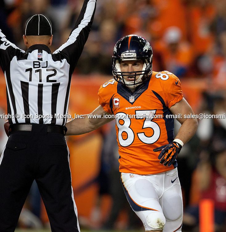 Sept. 23, 2013 - Denver, Colorado, U.S - Denver Broncos WR WES WELKER, right, hands the ball off to an official after catching a TD pass during the 2nd. half at Sports Authority Field at Mile High Monday Night. The Broncos beat the Raiders 37-21