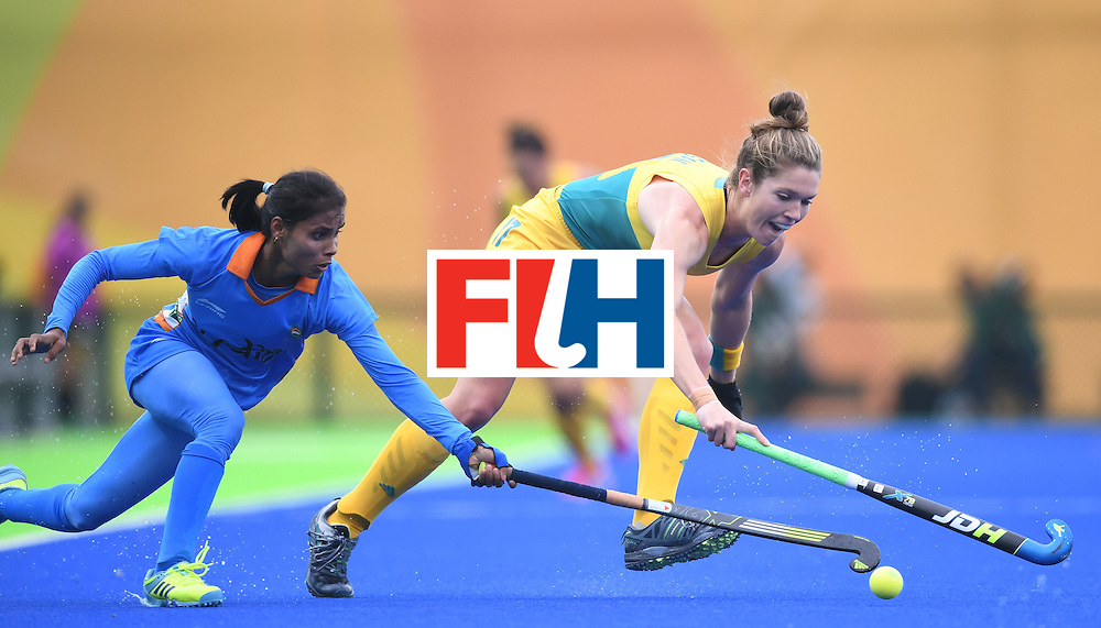 India's Vandana Katariya vies for the ball with Australia's Georgina Morgan during the women's field hockey India vs Australia match of the Rio 2016 Olympics Games at the Olympic Hockey Centre in Rio de Janeiro on August, 10 2016. / AFP / MANAN VATSYAYANA        (Photo credit should read MANAN VATSYAYANA/AFP/Getty Images)