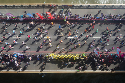 © Licensed to London News Pictures. 23/04/2017. LONDON, UK.  Mass marathon runners cross Tower Bridge, seen from the glass walkway of Tower Bridge, as the runners reach the half way point.  Photo credit: Vickie Flores/LNP
