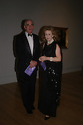 Richard Carew-Pole and Lady Wolfson. Turner Whistler Monet, exhibtion opening dinner, Tate Britain. 7 February 2005, ONE TIME USE ONLY - DO NOT ARCHIVE  © Copyright Photograph by Dafydd Jones 66 Stockwell Park Rd. London SW9 0DA Tel 020 7733 0108 www.dafjones.com