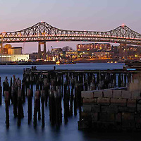 Night photography image of the Boston Tobin Bridge photographed in early spring at twilight. The Maurice J. Tobin Memorial Bridge (also referred to as the Mystic River Bridge) is a cantilever truss bridge that spans more than two miles from Charlestown to Chelsea over the Mystic River in Massachusetts. The bridge is the largest in New England and is operated by the Massachusetts Department of Transportation. It was erected between 1948 and 1950 and opened to traffic on February 2, 1950, replacing the former Chelsea Street Bridge. The 36-foot wide roadway has three lanes of traffic on each of the two levels with Northbound traffic on the lower level and Southbound traffic on the upper level.<br /> <br /> Photos of Boston Tobin Bridge are available as museum quality photography prints, canvas prints, acrylic prints or metal prints. Prints may be framed and matted to the individual liking and decorating needs: <br /> <br /> http://juergen-roth.artistwebsites.com/featured/boston-tobin-bridge-juergen-roth.html<br /> <br /> Good light and happy photo making! <br /> <br /> My best,<br />  <br /> Juergen<br /> www.RothGalleries.com <br /> www.ExploringTheLight.com <br /> http://whereintheworldisjuergen.blogspot.com<br /> https://twitter.com/naturefineart<br /> https://www.facebook.com/naturefineart