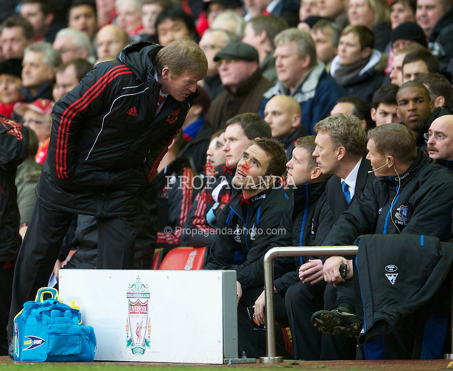 LIVERPOOL, ENGLAND - Sunday, January 16, 2011: Liverpool's manager Kenny Dalglish MBE puts Everton's manager David Moyes and staff in their place during the Premiership match at Anfield. (Photo by: David Rawcliffe/Propaganda)