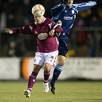 Forfar v St Johnstone....18.01.10   Scottish Cup<br /> Jody Morris gets a sore one from Martyn Fotheringham<br /> Picture by Graeme Hart.<br /> Copyright Perthshire Picture Agency<br /> Tel: 01738 623350  Mobile: 07990 594431