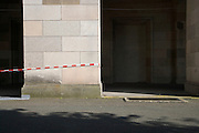 red and white protection tape placed around a big column at the former congress hall corridor Nuremberg
