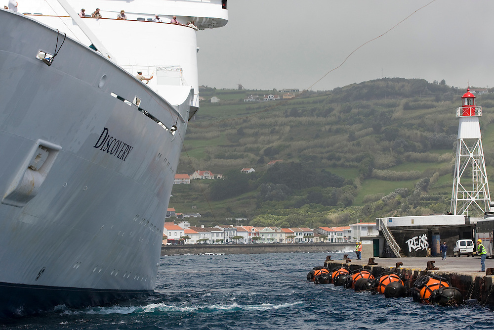 A cruise ship arrives at the commercial harbor of Horta and prepares to come alongside..Horta is on the Portuguese island of Faial, one of the Azores, which mark the most western boundaries of the E.U.