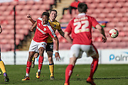 Christian Dibble (Barnsley) and Murray Wallace (Scunthorpe United) during the Sky Bet League 1 match between Barnsley and Scunthorpe United at Oakwell, Barnsley, England on 25 March 2016. Photo by Mark P Doherty.