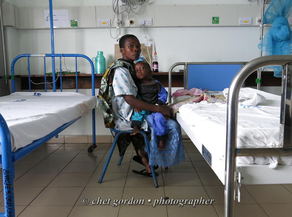 MWANZA, TANZANIA.  A Tanzanian mother with her child in the Semi-Intensive Care Unit at Bugando Medical Center in Mwanza, Tanzania on Thursday, September 4, 2014.  © Chet Gordon for AmeriCares