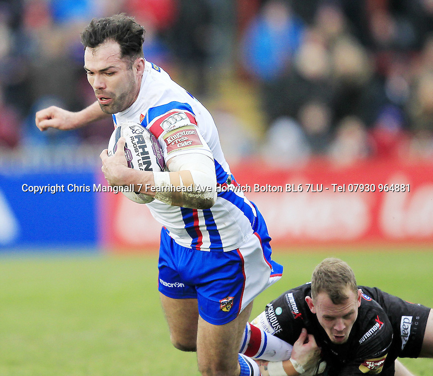 PICTURE BY CHRIS MANGNALL /SWPIX.COM...<br /> Rugby League - Super League -  Wakefield Wildcats v Widnes Vikings - Belle Vue Stadium Wakefield, England  - 07/02/16<br /> Wakefield's Anthony England  tackled by Widnes's   Kevin Brown