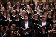 Tenor Thomas Cooley, left, and Baritone Stephen Powell, right, conducted by Music Director Robert Spano leads his Atlanta Symphony Orchestra and Chorus performing Britten's War of Requiem at Carnegie Hall in New York, NY on April 30, 2014.