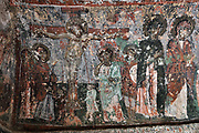 Crucifixion, fresco, 9th - 11th century, in Karabas Kilise, or the Black Head Church (as the painted figures have been blackened by smoke from oil lamps), in the Soganli Valley in Goreme, in Nevsehir province, Cappadocia, Central Anatolia, Turkey. The churches in Goreme are carved from the soft volcanic tuff created by ash from volcanic eruptions millions of years ago. Early christians came here to flee persecution by the Romans and others settled here under the influence of early saints. This area forms part of the Goreme National Park and the Rock Sites of Cappadocia UNESCO World Heritage Site. Picture by Manuel Cohen