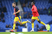 Crystal Palace midfielder James McArthur (18) and Crystal Palace defender Jeffrey Schlupp (15) warming up during the Premier League match between Everton and Crystal Palace at Goodison Park, Liverpool, England on 21 October 2018.