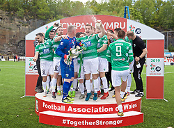 RHOSYMEDRE, WALES - Sunday, May 5, 2019: The New Saints' captain goalkeeper Paul Harrison lifts the trophy with Jon Routledge and Chris Marriott after the FAW JD Welsh Cup Final between Connah's Quay Nomads FC and The New Saints FC at The Rock. The New Saints won 3-0.(Pic by David Rawcliffe/Propaganda)