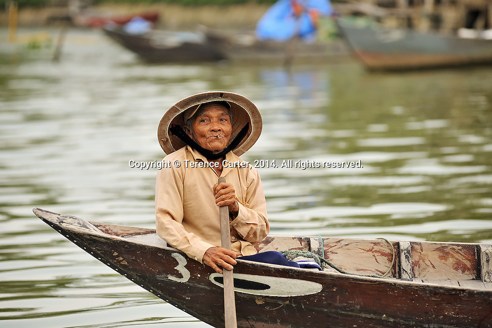 A woman waits for customers in her boat in Hoi An, Vietnam. Copyright 2014 Terence Carter / Grantourismo. All Rights Reserved.