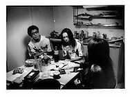 "Two young recovering hikikomori men ( L to R Ryo Takahashi & Ryohei Namiki) share a smoke and conversation with New Start staff, ""Yu-shan"" (she did not her complete name written) in kitchen of a New Start dormitory apartment.  New Start is an NPO organization that helps hikikomori enter society again...Hikikomori, which in Japanese means ""pull away"" are generally young men (80%) who isolate themselves from the outside world seeking shelter in their rooms often for years at a time."