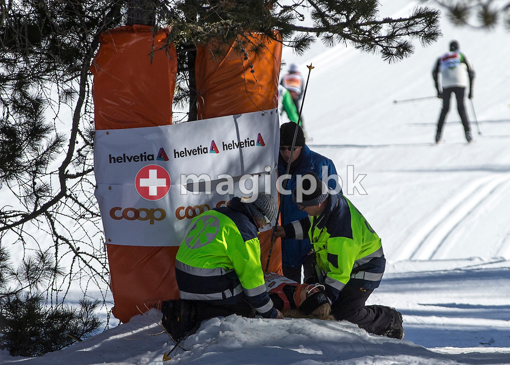 A participant is being cared by paramedics after crashing by a downhill in the Stazerwald near St. Moritz, during the annual Engadine cross-country skiing marathon from Maloja to S-Chanf in south Eastern Switzerland, Sunday,  March 10, 2013. Around 12'500 sportsmen and -women participated in the event. (Photo by Patrick B. Kraemer / MAGICPBK)