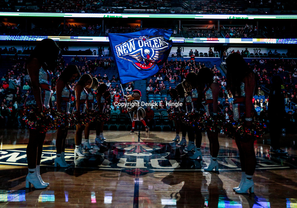 Jan 8, 2018; New Orleans, LA, USA; New Orleans Pelicans mascot Pierre the Pelican waves a flag in front of the Pelicans dance team during introductions before a game against the Detroit Pistons at the Smoothie King Center. Mandatory Credit: Derick E. Hingle-USA TODAY Sports