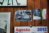 """AFFILE, ITALY - 23 AUGUST 2012: Fliers of faschist Marshall Rodolfo Graziani are scotched on the wall of Bar San Sebastiano in Affile, a town with a population of 1,600 80km east of Rome, on August 23, 2012. A mausoleum and park, dedicated to the memory of Fascist Field Marshall Rodolfo Graziani, has recently been opened in the Italian town of Affile. At a cost of €127,000 to local taxpayers, the mayor Ercole Viri has expressed hope that the site will become as 'famous and as popular as Predappio' – the burial place of Mussolini which has become a shrine to neo-Fascists. Rodolfo Graziani was the youngest colonel in the Regio Esercito (Royal Italian Army), known as the """"Butcher of Fezzan"""" and the """"Butcher of Ethiopia"""" for the brutal military campaigns and gas attacks he led in Libya and Ethiopia under the dictatorship of Benito Mussolini under which he then became Minister of Defence from 1943 to 1945."""