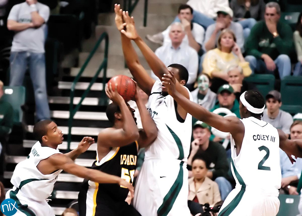 Appalachian State's Donte Minter goes up for a shot under pressure from Charlotte's Dijuan Harris, An'Juan Wilderness and Charlie Coley during Charlotte's 84-78 win over the Mountaineers Monday night at Halton Arena. The 49ers held Minter to 9 points on the night.