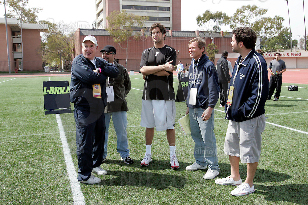 2 April 2006: Quarterback Matt Leinart with his father Bob, brother Ryan and agent Leigh Steinberg on the field  at NFL pro-timing day at USC college campus in Los Angeles, CA.