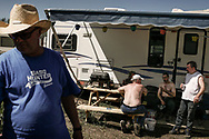 Oil company worker's on a day off at their trailers and mobile homes camp as they prefer to live in the forest, saving on expensive housing fares in Fort Mac Murray city. 29 June 2008.