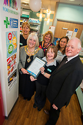 Lloyds Pharmacy Stocksbridge has achieved the status of 'Healthy Living Pharmacy'. A special accreditation for offering high levels of health screening  and advice to the local community. Pharmacy Manager Jackie Walter receiving the award from Mayor of Stocksbridge Susie Abrahams, also pictured left to right are Lloyds Stocksbridge Healthy Living Champion Vikki Sheppard, Valley Medical Centre Practace Manager Liz Sedgwick, Pharmacy Develpment Manager NHS Sheffield Jo Tsoneva and NHS Sheffield Commissioning Manager Gareth Johnstone,<br /> <br /> <br /> <br /> 04 October 2012<br /> Image © Paul David Drabble
