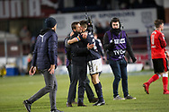 24th November 2017, Dens Park, Dundee, Scotland; Scottish Premier League football, Dundee versus Rangers; Dundee manager Neil McCann hugs captain Cammy Kerr at full time