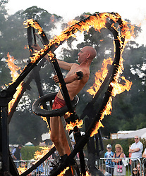 © Licensed to London News Pictures.03/08/2016. Thornton Le Dale, UK.  Joseph Peace inside a burning gyroscope as he demonstrates his spectacular fire stunts at the annual Thornton-le-Dale Show, Pickering, North Yorkshire.  Photo credit: Anna Gowthorpe/LNP