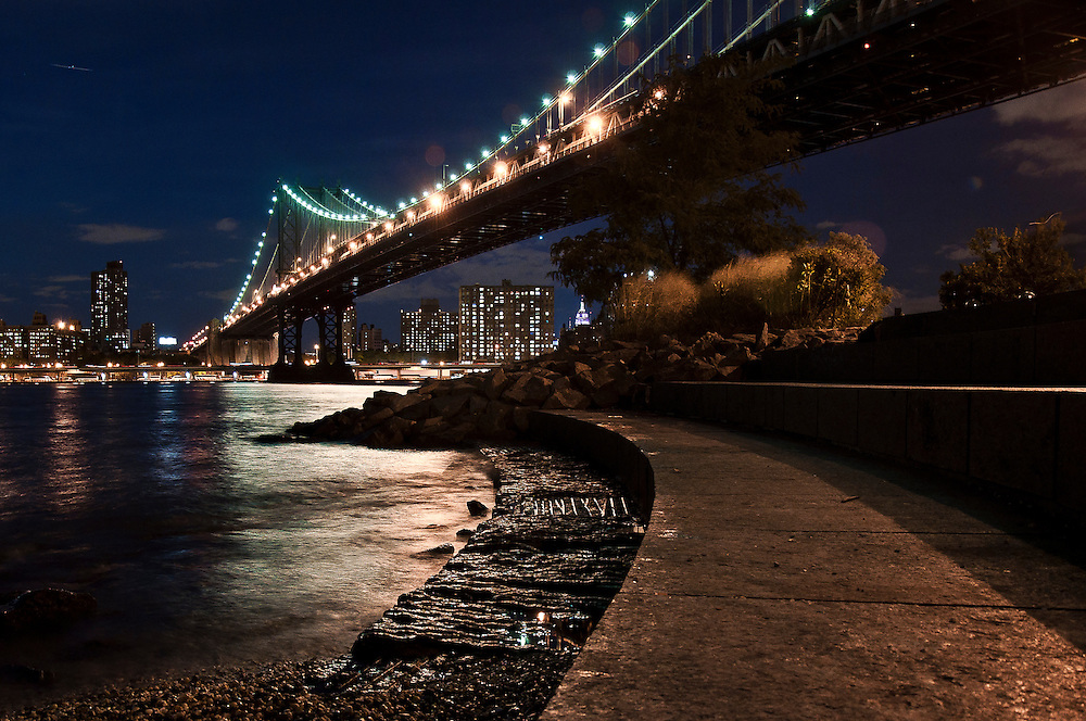 Manhattan Bridge by night as seen from the Brooklyn Bridge Park in DUMBO, Brooklyn, New York, 2009.