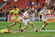 England's Will Edwards makes a break past Australia's Tom Kingston during the HSBC World Rugby Sevens Series - Singapore, Bronze match Australia-V-England at The National Stadium, Singapore on Sunday, April 16, 2017. (Steve Flynn/Image of Sport)