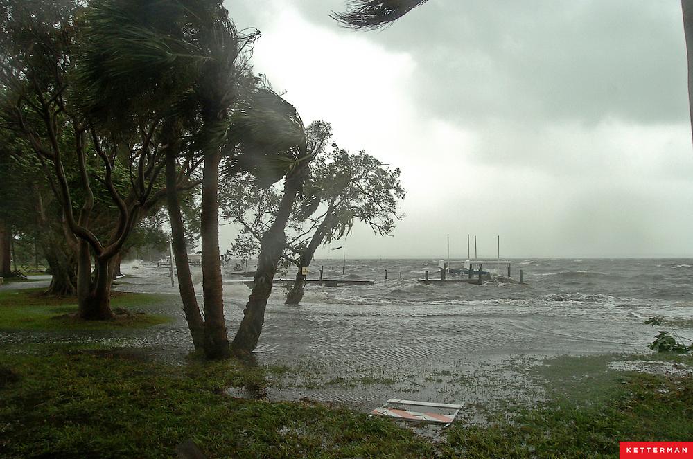 Storm surge from Hurricane Jeanne tops the sea wall along Palma Sola Boulevard in Bradenton, Florida.