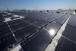 June 26, 2017 - Los Angeles, California, U.S - The newly completed 16.4-megawatt AC Westmont Solar Rooftop project, the most powerful solar rooftop installation in the world, Monday June 26, 2017 in Los Angeles. The 2 million-square-foot rooftop solar array will produce enough clean energy to power 5,000 Los Angeles homes, and in the process eliminate carbon emissions equivalent to taking 6,000 cars off the streets. (Credit Image: © Ringo Chiu via ZUMA Wire)
