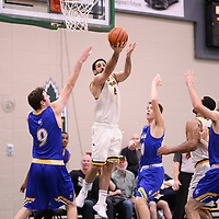 5th year guard Alex Igual (4) of the Regina Cougars during the Men's Basketball home game on November 24 at Centre for Kinesiology, Health and Sport. Credit: Arthur Ward/Arthur Images