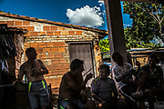 Members of the Sport Socho amateur soccer club ( Socho meaning drunk in slang Guarani language) chat and drink beer after a soccer match at the Chacarita slum  in Asuncion, Paraguay, Saturday, Dec. 16, 2017. Paraguay today is trying to promote a positive image of Guaran&iacute; language but bilingual education programme is under resourced and has failed to reach many areas of rural or impoverished parts of Paraguay, where Guaran&iacute; speakers are still schooled through Spanish, leading many to drop out.<br /> Part of the issue is that the language taught in schools is not that of the streets, with teachers tending to be puritanical and teaching words that have long since fallen out of use. (Dado Galdieri for The New York Times)