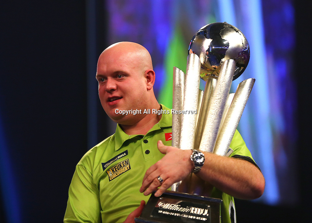 02.01.2017. Alexandra Palace, London, England. William Hill PDC World Darts Championship final  between top seeds Michael van Gerwen (1) and Gary Anderson (2). Michael van Gerwen celebrates winning the World Darts Final and lifts the Trophy, beating Defending World Champion Gary Anderson 7 sets to 3