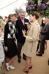 Left to right, SHARON STONE, ARNAUD BAMBERGER and CHARLOTTE CASIRAGHI at the 2013 Cartier Queens Cup Polo at Guards Polo Club, Berkshire on 16th June 2013.