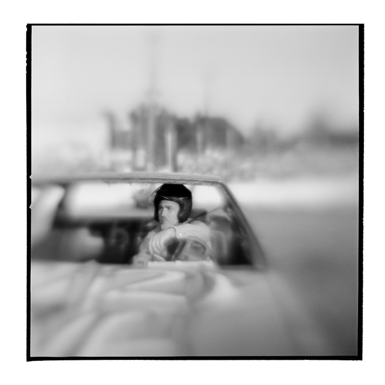 USA, Maryland, Mechanicsville, Blurred black and white image of driver waiting in car for start of Demolition Derby at Potomac Speedway