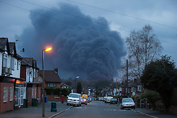 "© Licensed to London News Pictures . 15/03/2015 . Salford , UK . A large plume of smoke seen rising from the scene . Roads are closed and people have been evacuated as a large fire burns at a unit within "" Junction Eco-Park "" in Clifton , Greater Manchester , this evening (Sunday 15th March 2015) . The smoke and flames can be seen for many miles . Forty fire fighters are at the scene working to control the blaze . Photo credit : Joel Goodman/LNP"