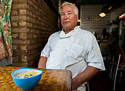 "Mike Grajewski, a Polish-Ukrainian former sheet metal worker and native Chicagoan, serves a Filipino specialty called ""Lugaw,"" at his restaurant Uncle Mike's Place on Tuesday, May 31, 2016. Nathan Weber for the New York Times"