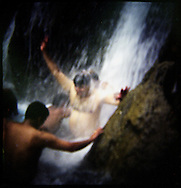 Indians enjoying a cool dip in the waters of the Mussourie Falls in North India