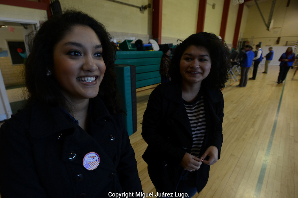 MANASSAS, VA - NOV 06, 2011: Jennifer Segovia, 19, at left, is excited after she cast her  vote for the first time at the polling station at the Jeannie Dean School in Manassas. This city is located in northern Virginia, a critical part of a crucial swing state. The Latino population has become a factor in the presidential race, especially for the Obama campaign. On the right is Segovia's friend Maria Alfaro, who is a resident alien and could not vote. (Photo by Miguel Juárez Lugo)