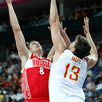 10 August 2012: Russia Sasha Kaun goes for the skyhook over Spain Marc Gasol during 67-59 Team Spain victory over Team Russia, during the men's basketball semi-finals, at the North Greenwich Arena, in London, Great Britain.